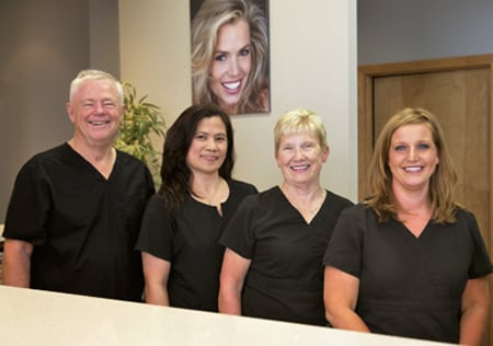 Photo of Dr. William Becker and the staff at Poplar Crossing Dental in Hoffman Estates.