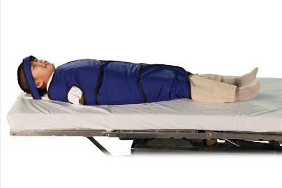 a child in a papoose board