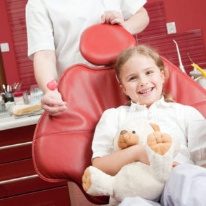 Little girl in a dental chair